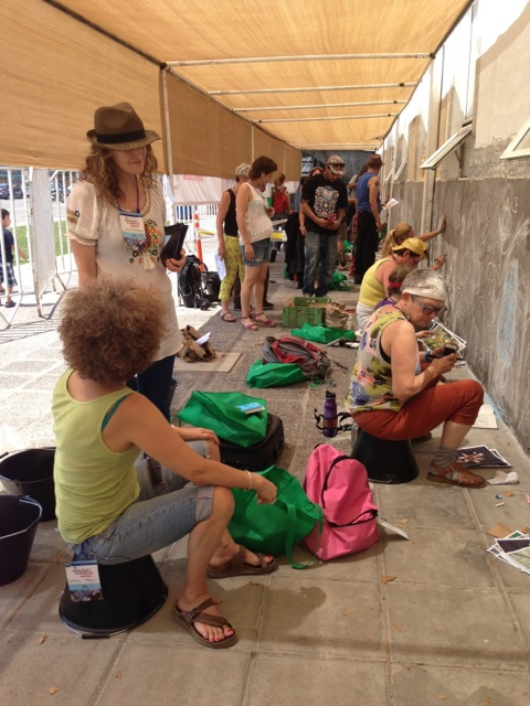 Mosaic artists at a wall beginning a project
